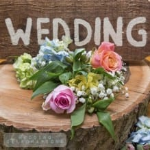 Wedding flowers next to a wedding sign