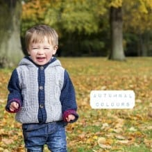 Boy laughing in autumnal park
