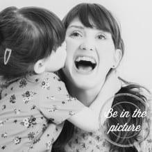 Little girl kissing her mum on the cheek
