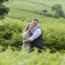 Engaged couple hugging in ferns